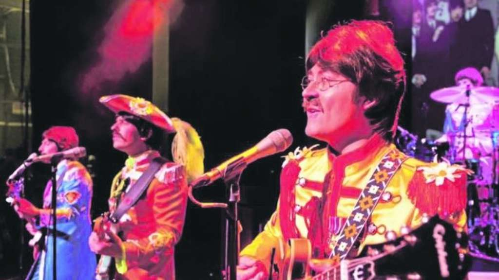 "Die Musiker der Beatles-Show ""Let It Be""."
