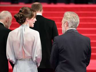Britain's Catherine, Duchess of Cambridge talks with British director Sam Mendes (R) on arrival for the world premiere of the new James Bond film 'Spectre' at the Royal Albert Hall in London on October 26, 2015. The film is directed by Sam Mendes and sees Daniel Craig play suave MI6 spy 007 for a fourth time. AFP PHOTO / LEON NEAL