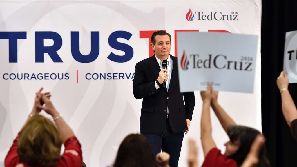 "Republican presidential candidate Ted Cruz speaks during a campaign event in Las Vegas, Nevada on February 22, 2016.Republican presidential contender Ted Cruz said he has asked his national spokesman to resign for a ""grave error of judgment"" in distributing a video that falsely suggested rival Marco Rubio was dismissive of the Bible. / AFP / JOSH EDELSON"